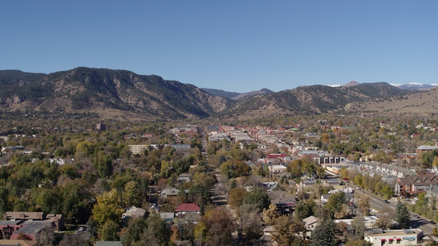 5.7K stock footage aerial video ascend while flying by Boulder, Colorado with mountains in background Aerial Stock Footage | DX0001_001924