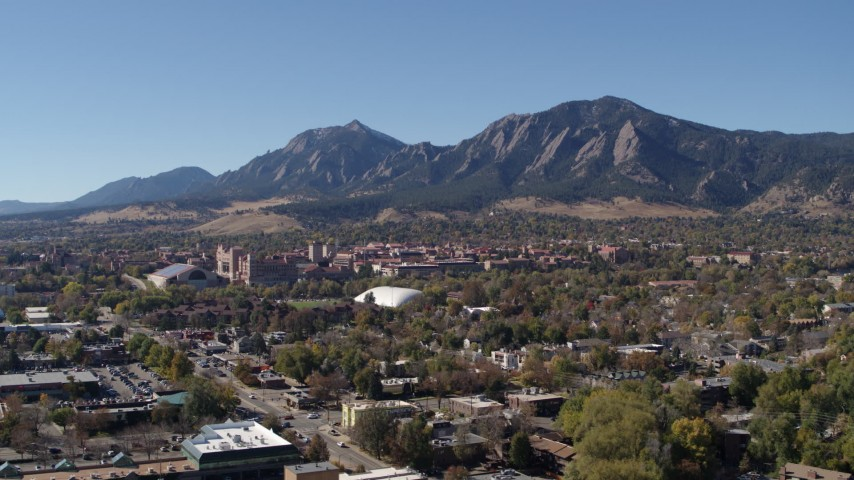 5.7K stock footage aerial video passing the University of Colorado Boulder and Green Mountain in distance Aerial Stock Footage | DX0001_001931