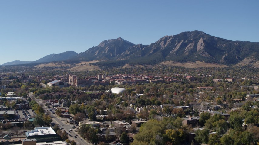 5.7K stock footage aerial video pass the University of Colorado Boulder and Green Mountain in distance Aerial Stock Footage | DX0001_001932