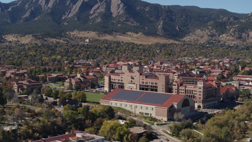 5.7K stock footage aerial video ascend and flyby campus buildings at the University of Colorado Boulder Aerial Stock Footage | DX0001_001943