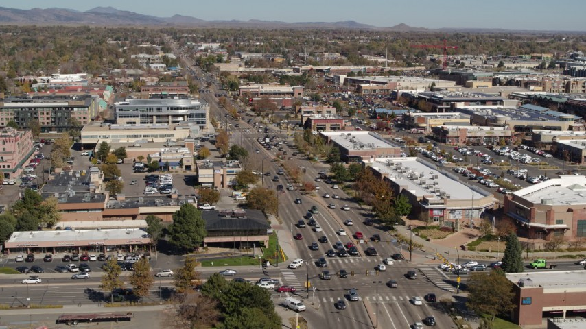 5.7K stock footage aerial video fly away from cars crossing an intersection in Boulder, Colorado Aerial Stock Footage | DX0001_001951
