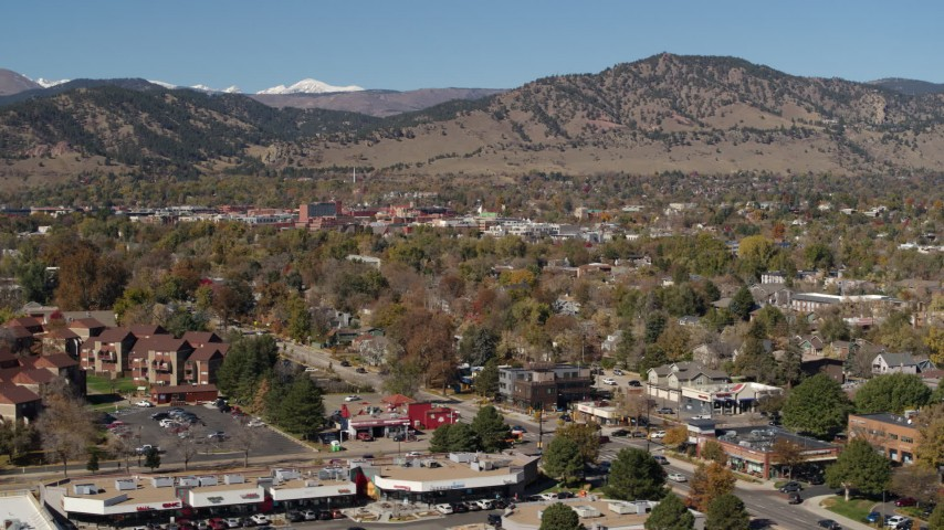5.7K stock footage aerial video of passing the mountain town of Boulder, Colorado seen from apartment buildings Aerial Stock Footage | DX0001_001954