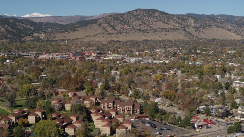 5.7K stock footage aerial video of flying by the mountain town of Boulder, Colorado and then descending Aerial Stock Footage | DX0001_001955