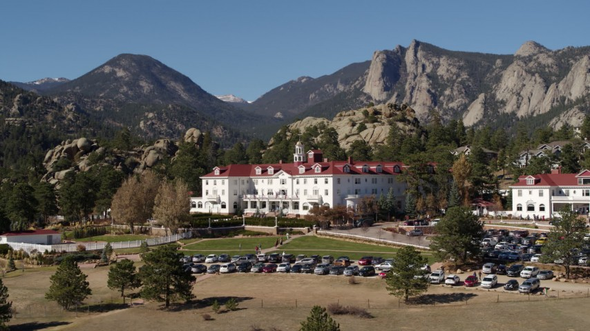 5.7K aerial video descend and flyby the historic Stanley Hotel in Estes Park, Colorado Aerial Stock Footage | DX0001_001965
