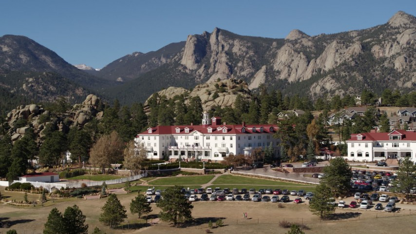 5.7K aerial video ascend and pass the historic Stanley Hotel in Estes Park, Colorado Aerial Stock Footage | DX0001_001967