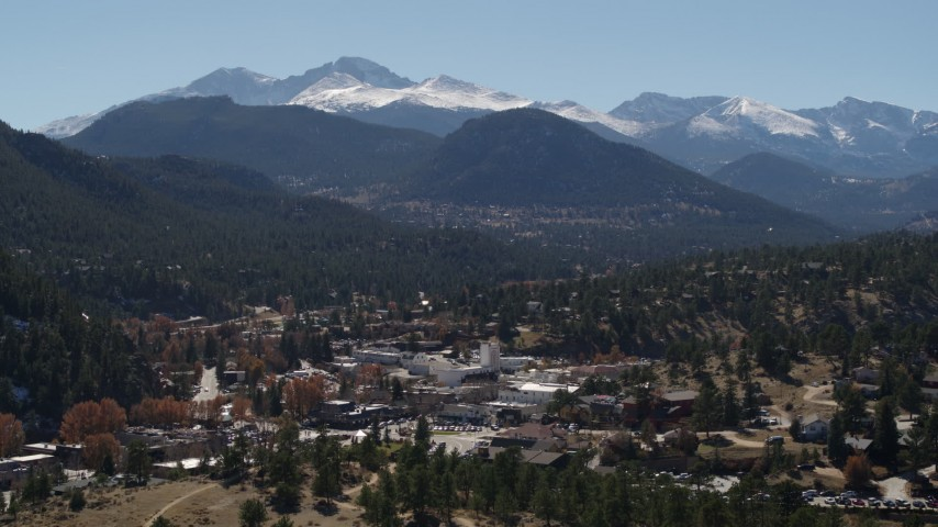 5.7K aerial video of the Rocky Mountains and the town of Estes Park, Colorado while ascending Aerial Stock Footage | DX0001_001971