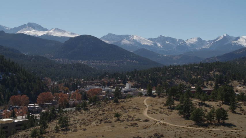 5.7K stock footage aerial video of the Rocky Mountains and the mountain town of Estes Park, Colorado while descending Aerial Stock Footage | DX0001_001973