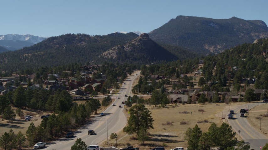 5.7K aerial video of a road through the town of Estes Park, Colorado near mountains Aerial Stock Footage | DX0001_001974