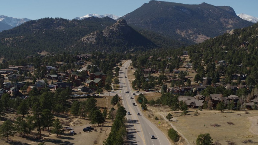 5.7K aerial video of cars on a road through the town of Estes Park, Colorado Aerial Stock Footage | DX0001_001975