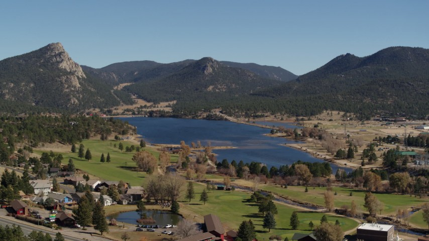 5.7K aerial video of Lake Estes by golf course and green mountains in Estes Park, Colorado Aerial Stock Footage | DX0001_001978