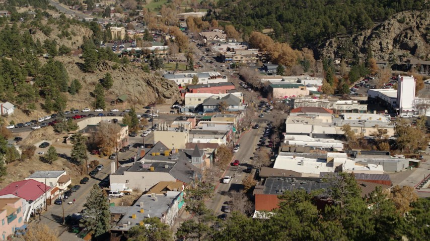 5.7K aerial video of shops lining the road through Estes Park, Colorado seen during descent Aerial Stock Footage | DX0001_001987