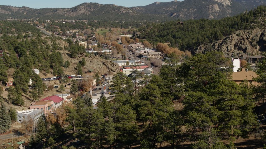 5.7K aerial video reverse of road through Estes Park, Colorado Aerial Stock Footage | DX0001_001988