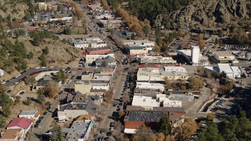 5.7K stock footage aerial video stationary view of shops on road through Estes Park, Colorado Aerial Stock Footage | DX0001_001991