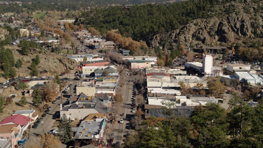 5.7K aerial video a reverse view of shops on road through Estes Park, Colorado Aerial Stock Footage | DX0001_001992