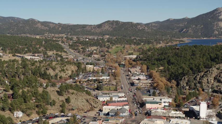 5.7K stock footage aerial video reverse and flyby of road through Estes Park, Colorado Aerial Stock Footage | DX0001_001995