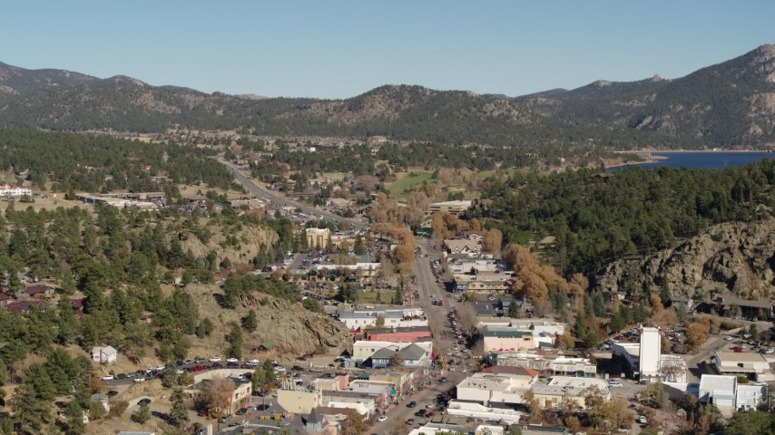 5.7K stock footage aerial video flyby shops lining road through Estes Park, Colorado while ascending Aerial Stock Footage | DX0001_001997