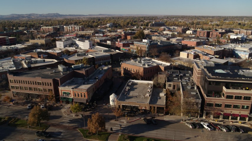 5.7K stock footage aerial video of approaching brick office buildings and shops in Fort Collins, Colorado Aerial Stock Footage DX0001_002009 | Axiom Images