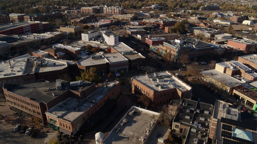 5.7K stock footage aerial video of a reverse view of brick office buildings and shops in Fort Collins, Colorado Aerial Stock Footage | DX0001_002010