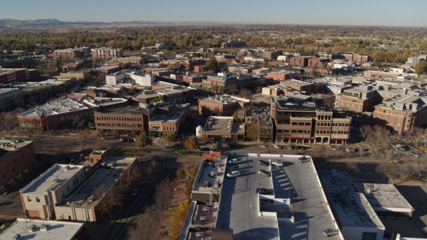 5.7K stock footage aerial video of an approach to brick office buildings and shops in Fort Collins, Colorado Aerial Stock Footage | DX0001_002011