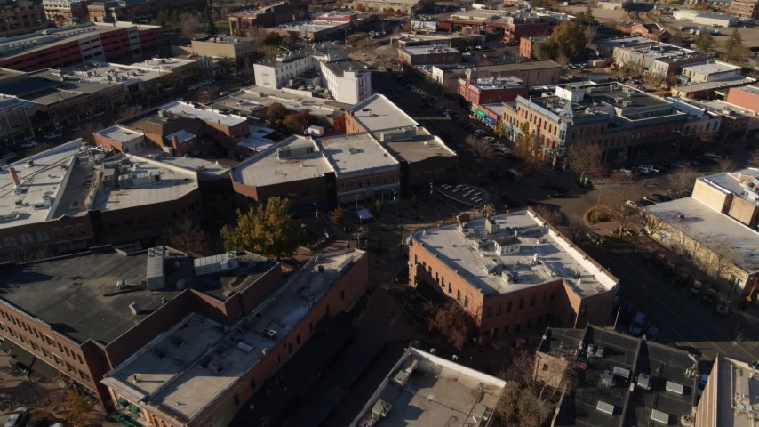 5.7K stock footage aerial video of flying away from brick office buildings and shops in Fort Collins, Colorado Aerial Stock Footage | DX0001_002012