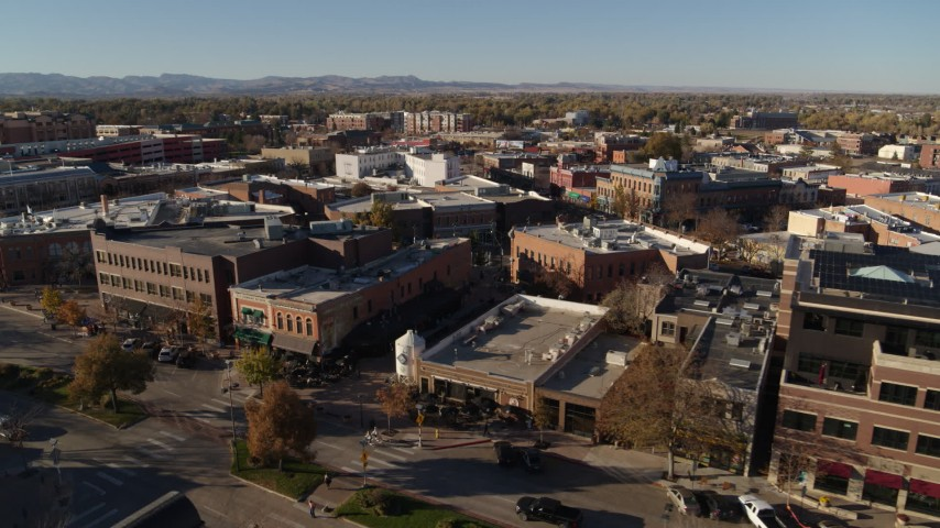 5.7K stock footage aerial video pass a row of brick office buildings and shops in Fort Collins, Colorado Aerial Stock Footage | DX0001_002016
