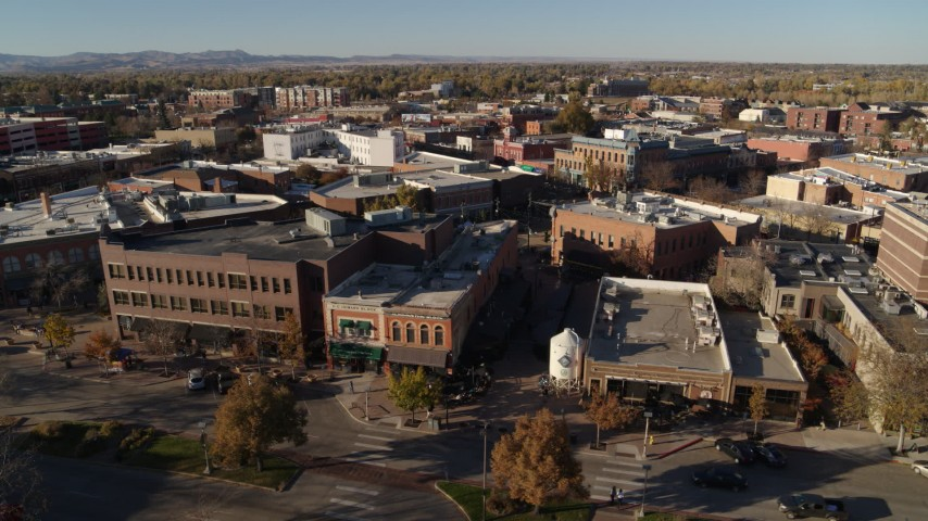 5.7K stock footage aerial video slowly passing a row of brick office buildings and shops in Fort Collins, Colorado Aerial Stock Footage | DX0001_002018