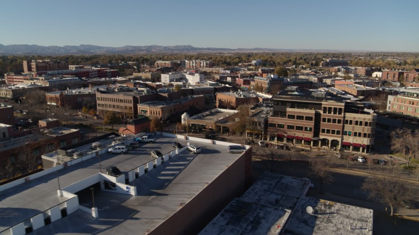 5.7K stock footage aerial video fly away from a row of brick office buildings and shops in Fort Collins, Colorado Aerial Stock Footage | DX0001_002019