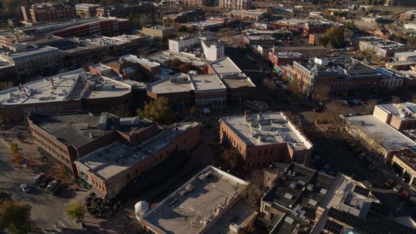 5.7K stock footage aerial video of shops while descending near office buildings in Fort Collins, Colorado Aerial Stock Footage | DX0001_002021