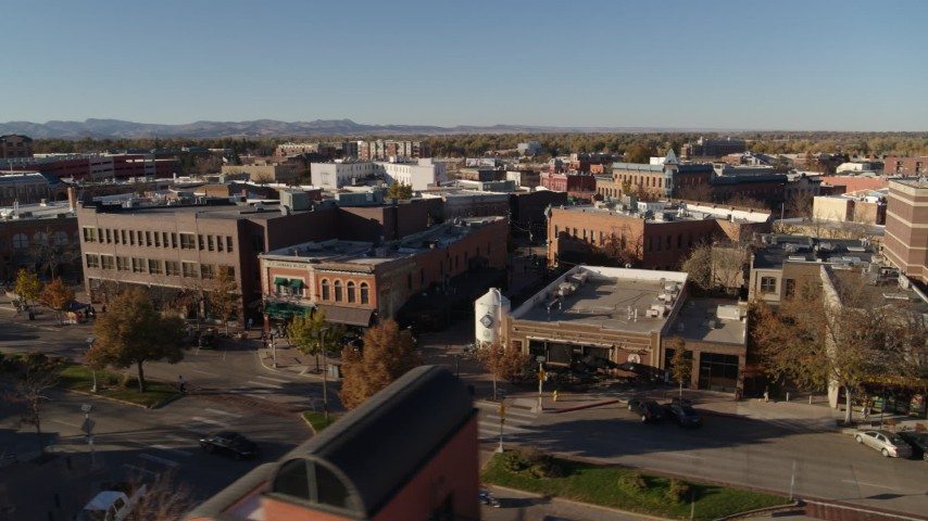 5.7K stock footage aerial video fly away from shops and office buildings before ascent in Fort Collins, Colorado Aerial Stock Footage | DX0001_002022