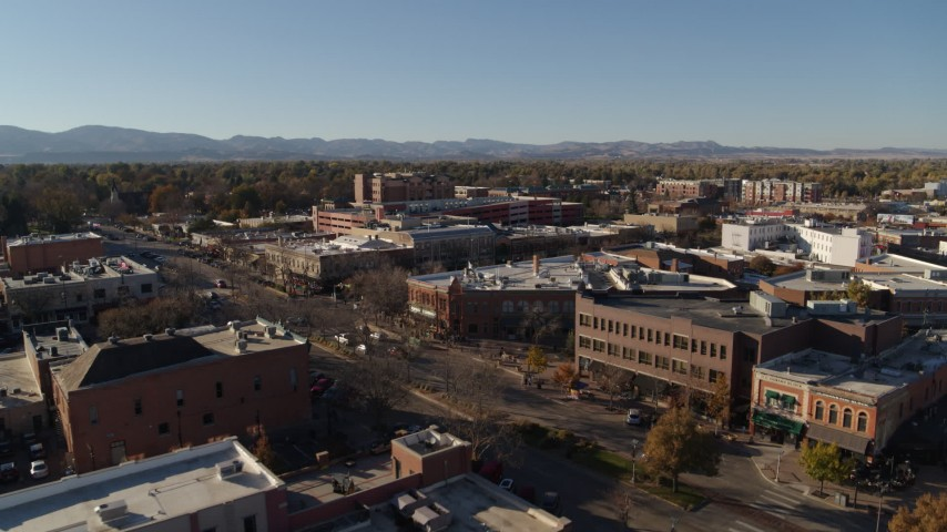 5.7K stock footage aerial video of a reverse view of shops and office buildings in Fort Collins, Colorado Aerial Stock Footage | DX0001_002027