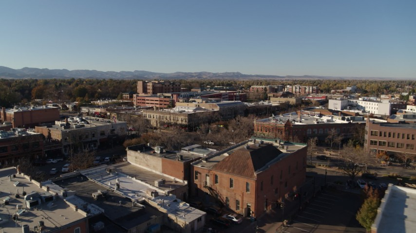 5.7K stock footage aerial video of an approach to shops and office buildings in Fort Collins, Colorado Aerial Stock Footage | DX0001_002028