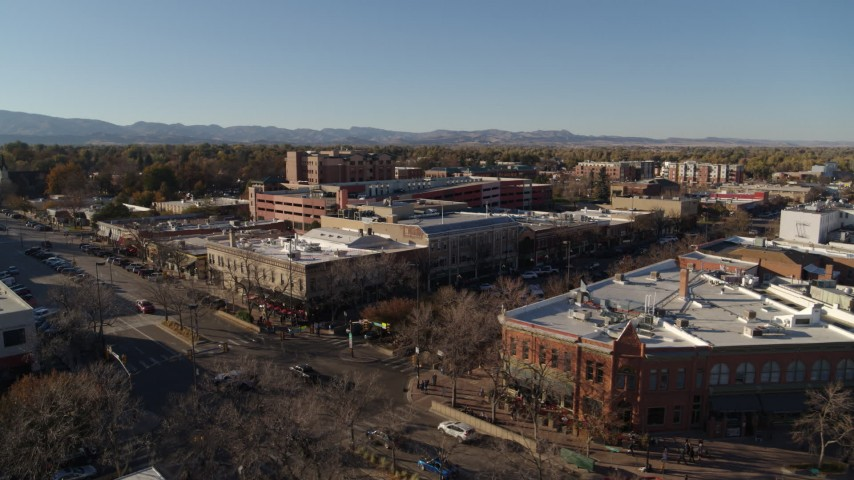 5.7K stock footage aerial video approach and fly away from shops and office buildings in Fort Collins, Colorado Aerial Stock Footage | DX0001_002029
