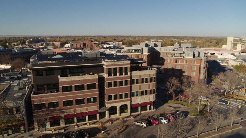 5.7K stock footage aerial video of a brick office building in Fort Collins, Colorado Aerial Stock Footage | DX0001_002030