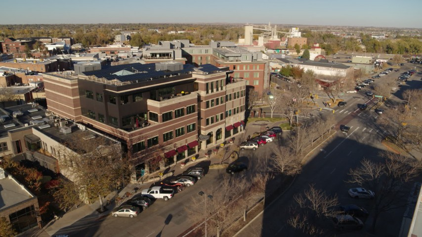 5.7K stock footage aerial video of passing by a brick office building in Fort Collins, Colorado Aerial Stock Footage | DX0001_002032