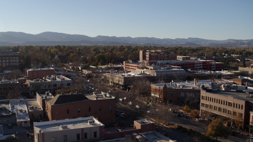 5.7K stock footage aerial video flyby and away from a brick office buildings and shops in Fort Collins, Colorado Aerial Stock Footage | DX0001_002033