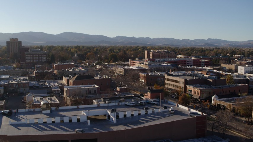 5.7K stock footage aerial video reverse view and flyby a brick office buildings and shops in Fort Collins, Colorado Aerial Stock Footage | DX0001_002034