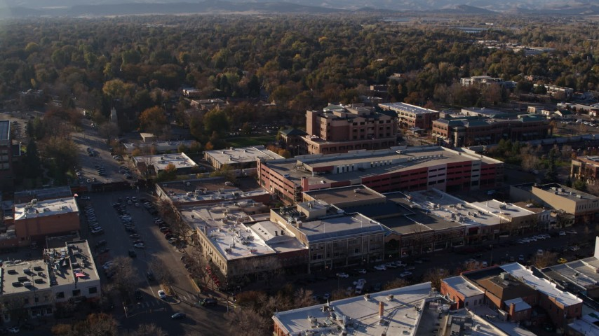 5.7K stock footage aerial video of a view of office buildings, shops, parking garage in Fort Collins, Colorado Aerial Stock Footage | DX0001_002037