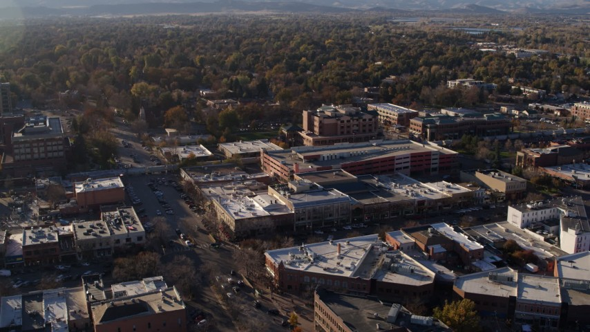 5.7K stock footage aerial video fly away from office buildings, shops, parking garage in Fort Collins, Colorado Aerial Stock Footage | DX0001_002038