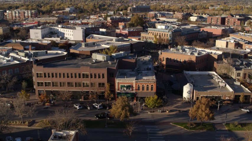5.7K stock footage aerial video pan across brick office buildings and street level shops in Fort Collins, Colorado Aerial Stock Footage | DX0001_002046