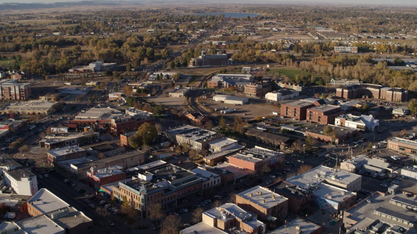 5.7K stock footage aerial video of railroad tracks separating office buildings and warehouses in Fort Collins, Colorado Aerial Stock Footage | DX0001_002050