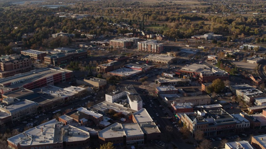 5.7K stock footage aerial video of railroad tracks separating office buildings and warehouses in Fort Collins, Colorado Aerial Stock Footage | DX0001_002051