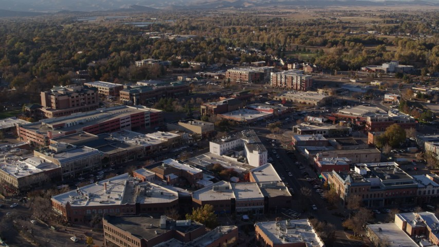 5.7K stock footage aerial video fly away from and flyby shops and office buildings by wide streets in Fort Collins, Colorado Aerial Stock Footage | DX0001_002055