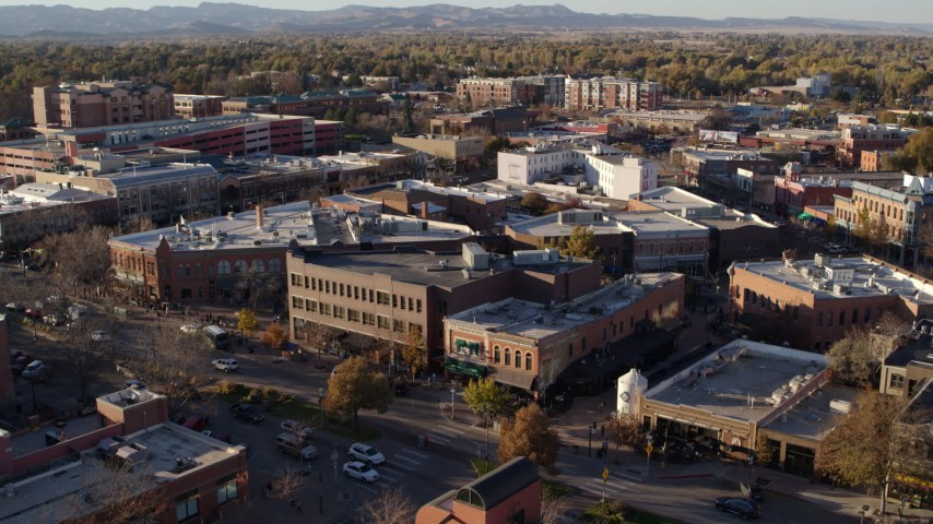 5.7K stock footage aerial video shop with green awning and brick office building in Fort Collins, Colorado Aerial Stock Footage | DX0001_002056