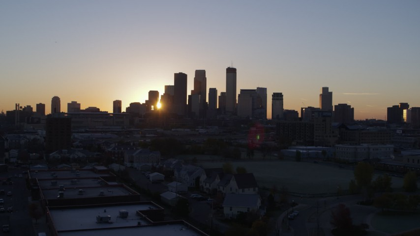 5.7K stock footage aerial video of the rising sun behind the city's skyline in Downtown Minneapolis, Minnesota Aerial Stock Footage | DX0001_002061
