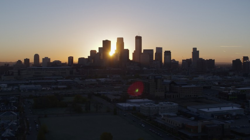5.7K stock footage aerial video flyby the city's skyline as the sun rises in Downtown Minneapolis, Minnesota Aerial Stock Footage | DX0001_002063