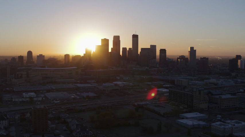 5.7K stock footage aerial video flyby the city's skyline as the sun rises in Downtown Minneapolis, Minnesota Aerial Stock Footage | DX0001_002064