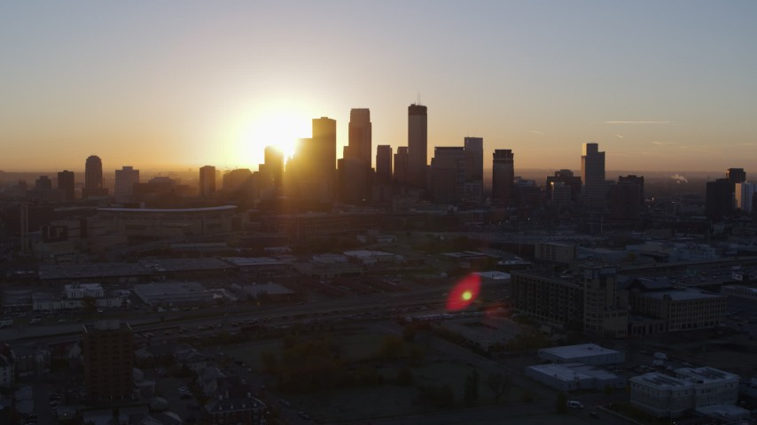 5.7K stock footage aerial video flying by the city's skyline as the sun rises in Downtown Minneapolis, Minnesota Aerial Stock Footage | DX0001_002065