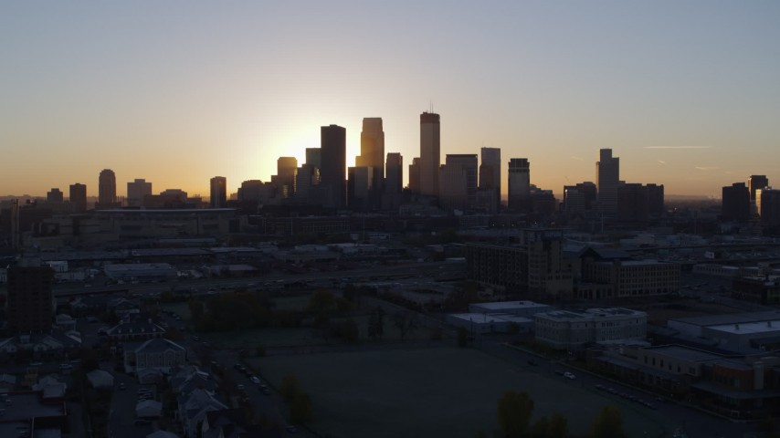 5.7K stock footage aerial video approach the city's skyline as the sun rises and ascend in Downtown Minneapolis, Minnesota Aerial Stock Footage | DX0001_002066