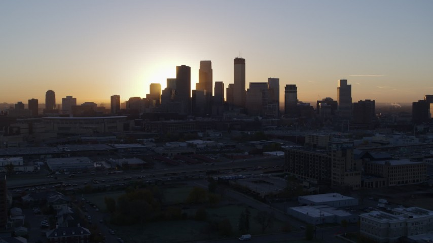 5.7K stock footage aerial video of the city's skyline as the sun rises in Downtown Minneapolis, Minnesota during descent Aerial Stock Footage | DX0001_002067