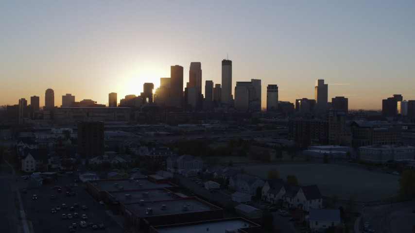5.7K stock footage aerial video of passing the city's skyline as the sun rises in Downtown Minneapolis, Minnesota during ascent Aerial Stock Footage | DX0001_002068